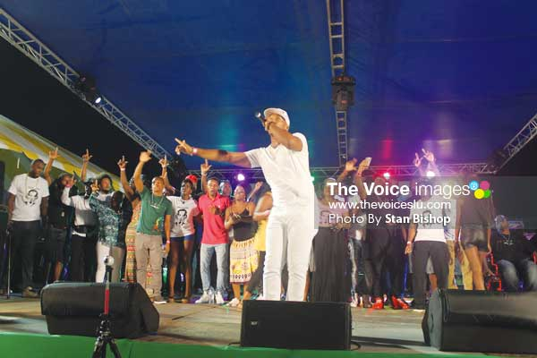 "Image: Groovy soca monarch, Arthur, leads the star-studded cast in a performance of ""Unconditional Love"". (PHOTO: Stan Bishop)"