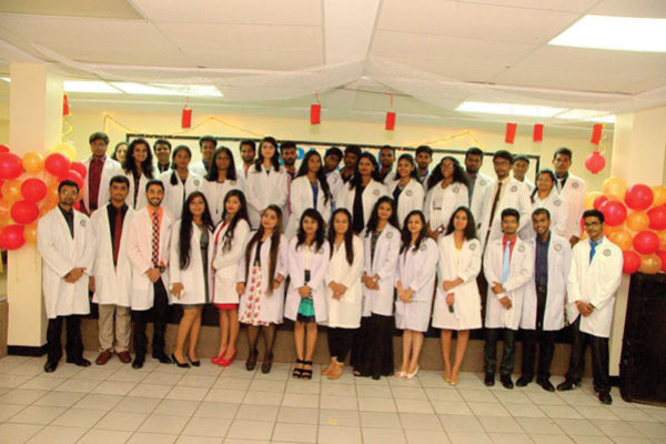 img: The latest batch of medical students at Spartan University in Vieux Fort