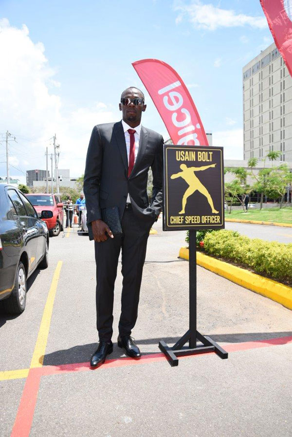 img: Usain Bolt, Digicel's Chief Speed Officer (CSO), checks out his designated parking slot on his first day at work at the Digicel regional HQ.