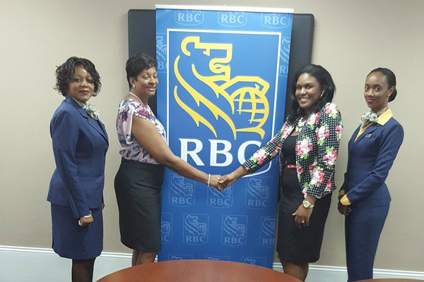 img: Left to right: Ms. Farrah Biscette, Assistant Manager Client Care; Mrs. Angella Boulogne, Principal Odsan Combined; Thalia Charles, CSR; and Myreen Cenac, Community Outreach Champion.