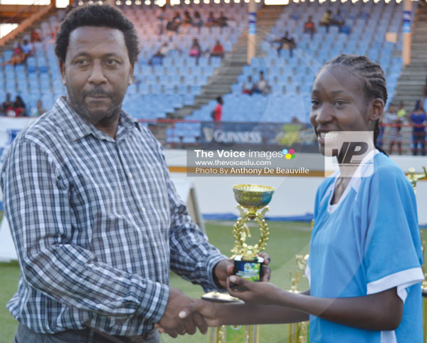 IMG: SLFA President Lyndon Cooper presenting the trophy for most Goals in the tournament (9) to Sasha Prospere of Soufriere. (Photo Anthony De Beauville)