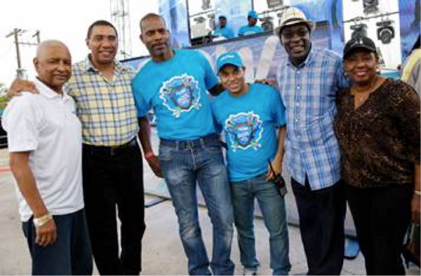 img: Prime Minister of Jamaica, The Most Honorable Andrew Holness (2nd left) is flanked by (from L- R) Errol Miller, Executive Chairman of the FLOW Foundation; Garry Sinclair, Managing Director, FLOW Jamaica; Carlo Redwood, VP Marketing & TV; the Hon. Senator Ruel Reid, Minister of Education, Youth and Information and the  Hon. Olivia Grange, Minister of Culture, Gender, Entertainment & Sport.