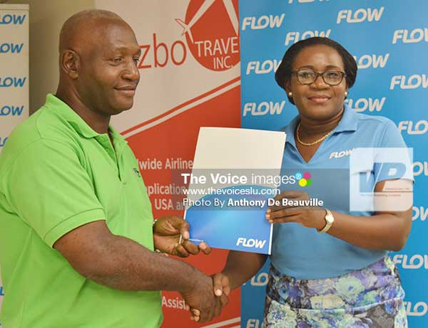 Image: (L-R) Best Coach, Vieux Fort South's Emmanuel Bellas, receiving an award from FLOW representative Adriana Mitchel-Gideon. (Photo: Anthony De Beauville)
