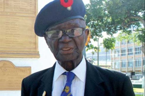World War II veteran, Haynes Cyril, at the War Memorial in Derek Walcott Square. [Photo: Stan Bishop]