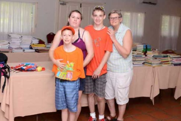 Image: Noah and his family before repacking boxes for school.