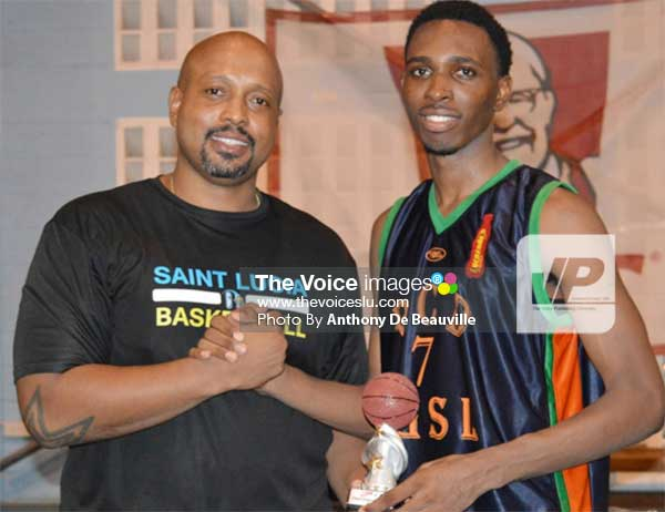 Image: (L-R) President of the SLBF Leslie Collymore presenting Troy Louison with his award for Most Steals/MVP of the Tournament. (PHOTO: Anthony De Beauville)