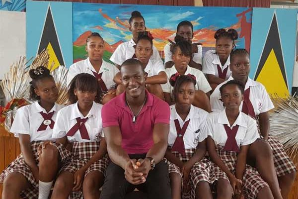 Image: Sammy with Gros Islet Secondary students.