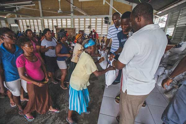 iMAGE: Sandals distributing relief supplies in Haiti