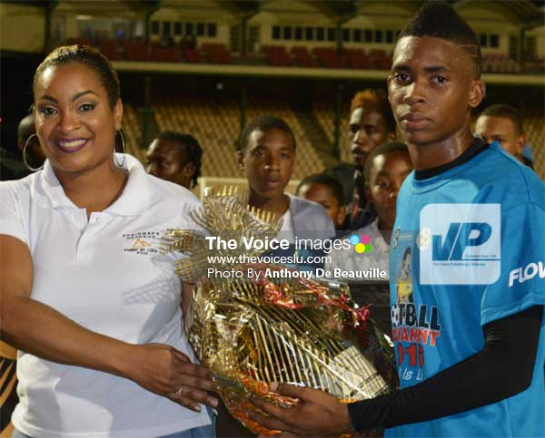 Image: (L-R) St. Lucia Distillers representative presenting award to VFS goalkeeper Leon Alexander, the MVP of the tournament. (PHOTO: Anthony De Beauville)