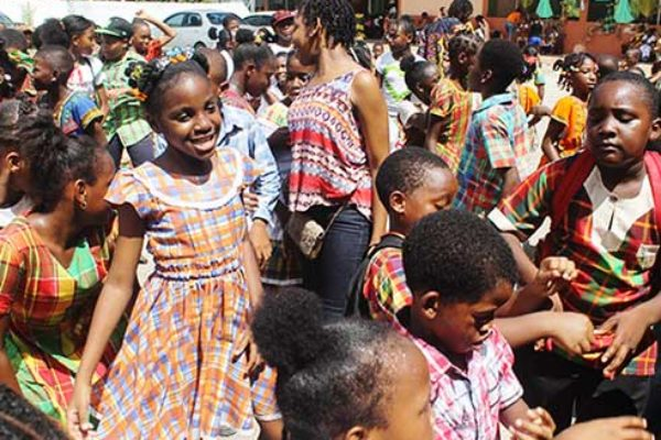 Image: Students of the Gordon and Walcott Memorial School in Castries (left) and Grace Combined in Vieux Fort (right) in the thick of JounenKweyol activities yesterday.