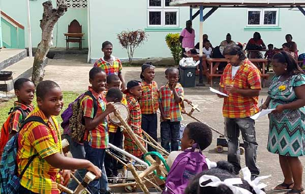 Image: Students of the Gordon and Walcott Memorial School in Castries (left) and Grace Combined in Vieux Fort (right) in the thick of Jounen Kweyol activities yesterday.