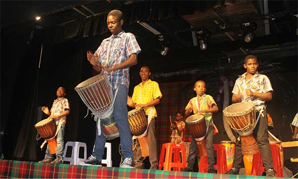Image of Young drummers entertaining.