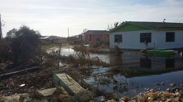 img: Houses in Andros flooded as a result of heavy rains caused by Hurricane Matthew.
