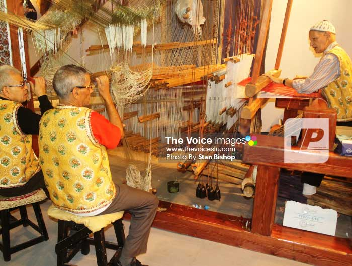 Image: Morrocan craftsmen producing fabric at an artisans' exhibition in Marrakech.