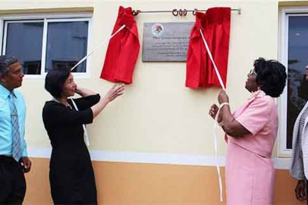 Image: Ambassador Socorra and Dame Pearlette unveil a plaque on one of the buildings.