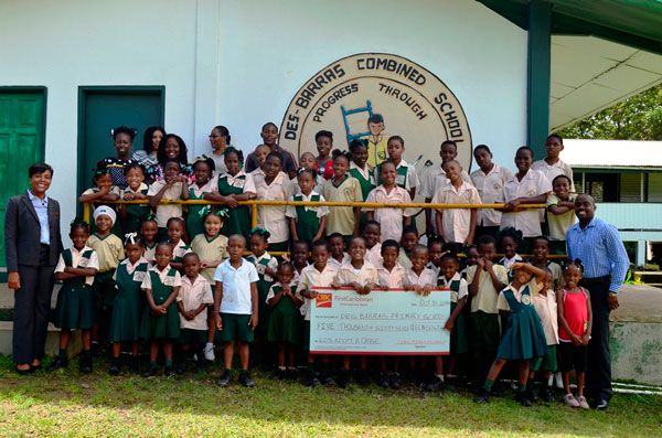 img: Students, staff, principal of the Des Barras Combined with CIBC FCIB Country Manager.