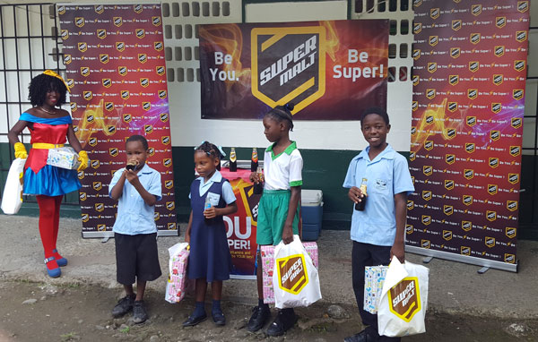 img; Four students from La Croix Maingot Combined receive early Christmas gifts from SuperMalt.