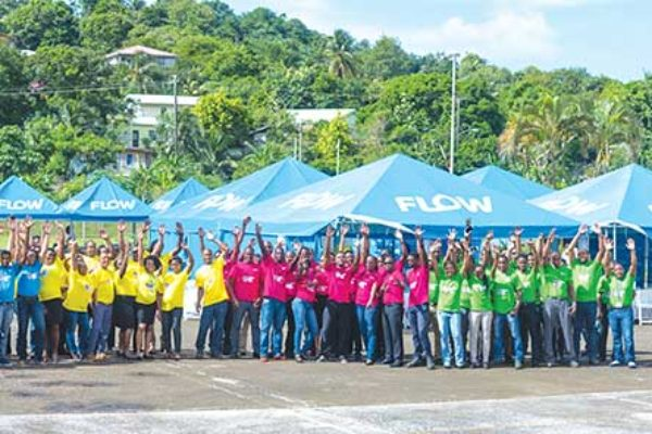 Image: FLOW Staff celebrating Mission Day