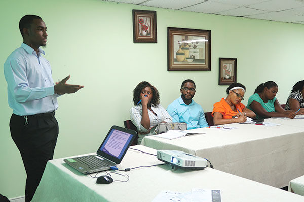 Image: JA Volunteer Wilton Jeremie Facilitates training
