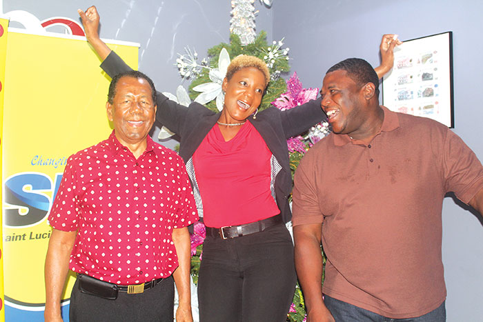 Image: Mary Edward, Regional Marketing Manager of CBN St. Lucia Inc./CBN Dominica Inc. shares the joy of big winners Geoffrey Stephenson (left) and Peter Christophe