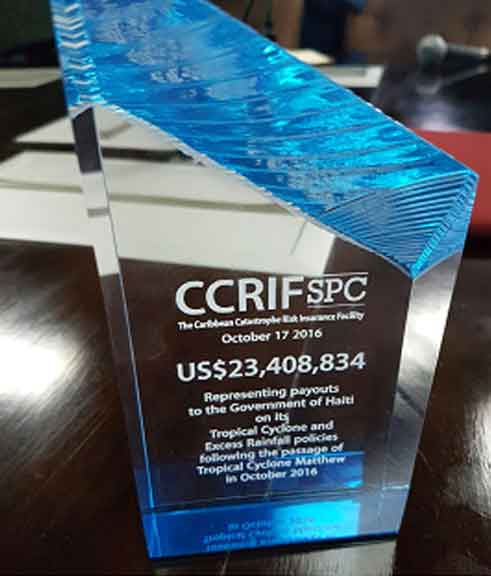 Image: Memento symbolizing the payouts of US$23.4 million made by CCRIF to the Government of Haiti on October 17, 2016 -- 14 days after Hurricane Matthew affected the island. The payouts were made on Haiti's tropical cyclone and excess rainfall policies, which were triggered by Matthew.