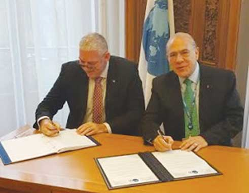 Image: Prime Minister Chastanet signing the agreement in Paris