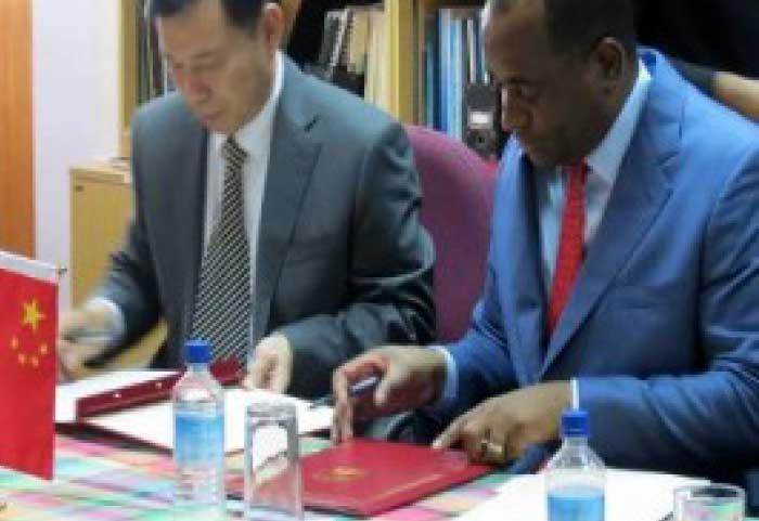 Image: Prime Minister Roosevelt Skerrit (right) and China Ambassador Lu Kun, signing agreements