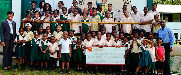 Image: Students, staff, principal of the Des Barras School with CIBC/FCIB Country Manager.