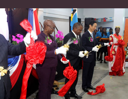 Image: Taiwan's Ambassador to Saint Lucia, Ray Mou, (fourth from left), Ministers Stephenson King and Fortuna Belrose, and President of the Senate, Andy Daniel, cut the ribbon to declare this year's trade exhibition open yesterday. [PHOTO: Stan Bishop]
