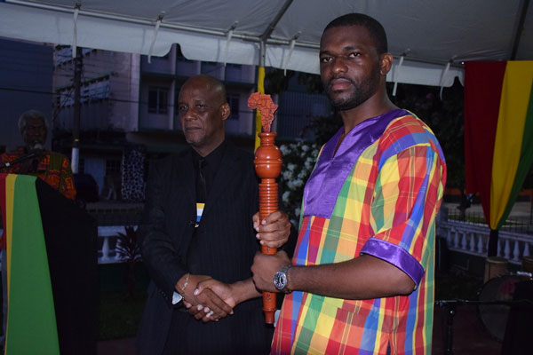 img: Castries Mayor Peterson Francis passed the CARICOM Reparations Baton to Saint Lucia's CARICOM Youth Ambassador Charde Desir, who is also Dean of the CARICOM Youth Ambassadors.