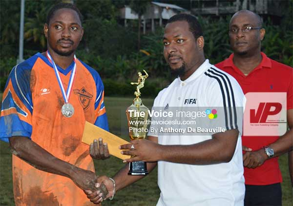 Image: (L-R) Captain of the Aux Lyon team receiving the second place trophy and monetary prize from Mabouya Valley Football League chairman Kendal Emmanuel. (PHOTO:  Anthony De Beauville)