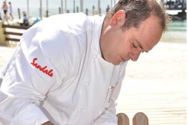 Image: Chef Henrique prepares Lionfish