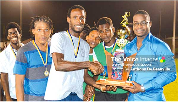 Image: Members of Massy Northern United football team receiving the championship trophy from Sports Saint Lucia Online Managing Director Kenson Casimir (Photo: Anthony De Beauville)