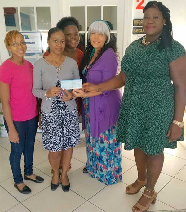 Image: Nurse Posvar (second from right) receives the donation.