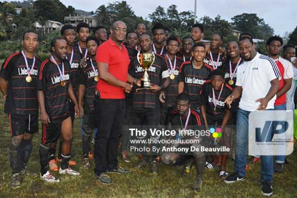 Image: Parliamentary Representative for Dennery North, Shawn Edward, presenting Survivals captain with the 2016 championship trophy . (PHOTO: Anthony De Beauville)
