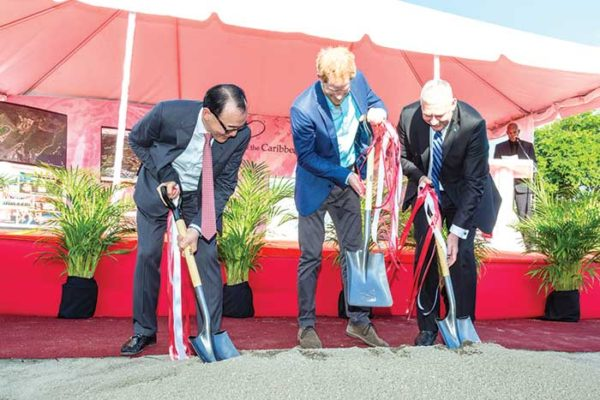 Image: Sod turning: Chairman of DSH Caribbean Star Ltd and China Horse Club, Mr. Teo Ah Khing, Prince Harry and Prime Minister Chastanet break ground for the project.