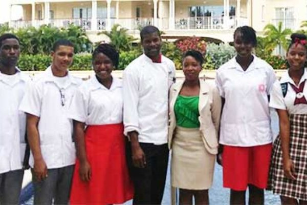 Image of Chef Mark (centre) flanked by students and teachers.