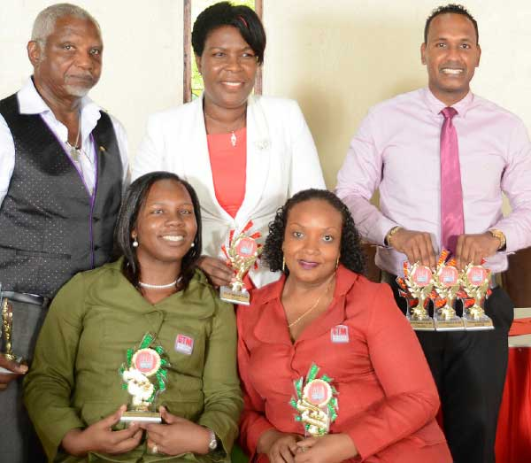 Image: Standing , left to right:  Mr. Clinton Charlery , Ms. Bernadette Jn Charles and Mr. Kirk Maraj. Seated – Mrs. Tessa Daniel and Ms. Emmalee Emmanuel (Employees of the Year).