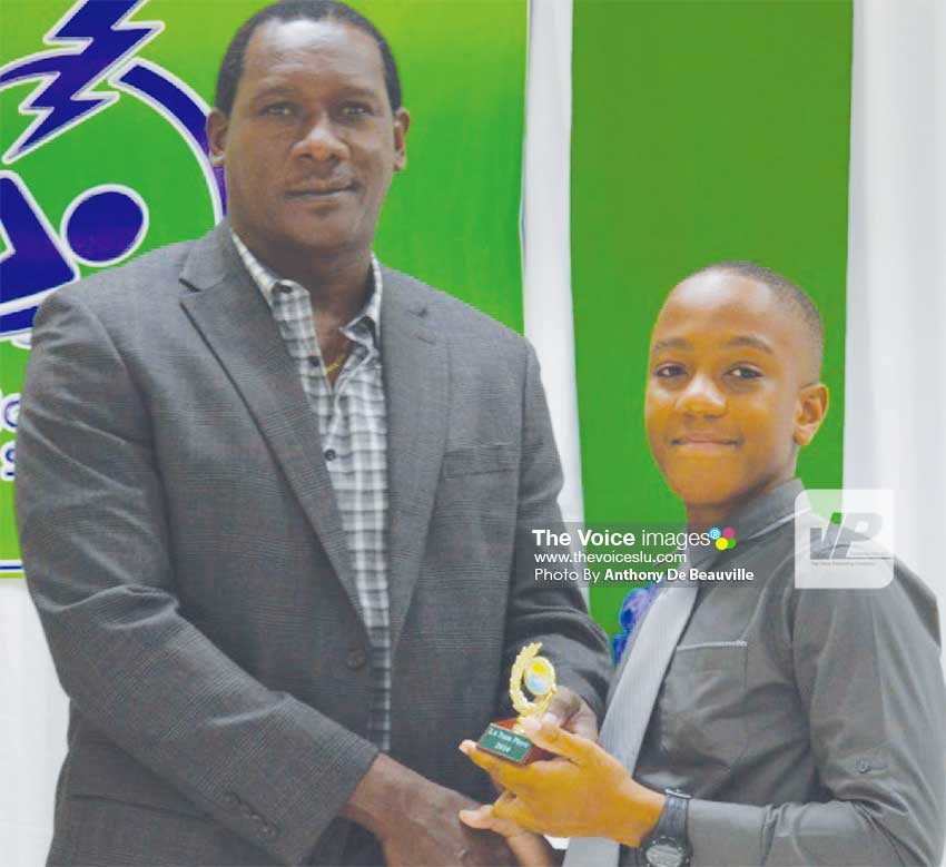 Image: Parliamentary representative for Gros Islet Lenard Montoute presenting Andre Samuel with his award. (Photo: Anthony De Beauville)