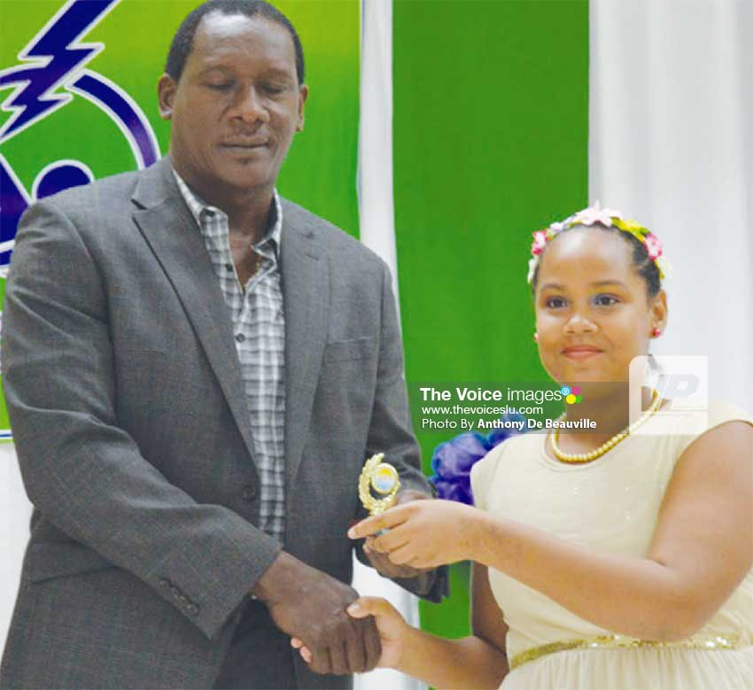 Image: Parliamentary representative for Gros Islet Lenard Montoute presenting Angelique Gaillard with her award. (Photo: Anthony De Beauville)