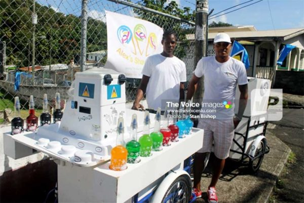 Image: David Alexander Growth (right) and his assistant, Jeanmal, with their sno cone cart in La Clery. [PHOTO: Stan Bishop]