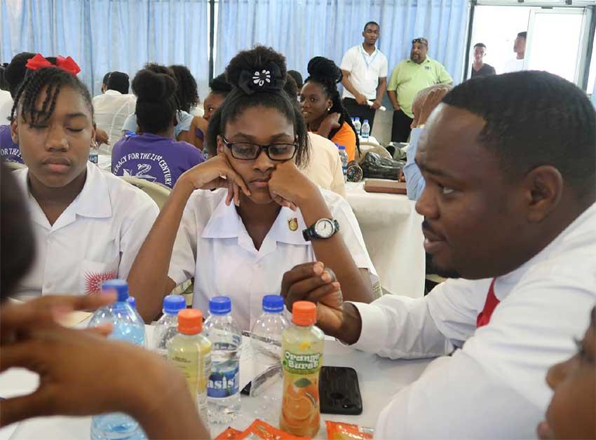 Image: JA volunteer Wilton Jeremie pep talks some students.