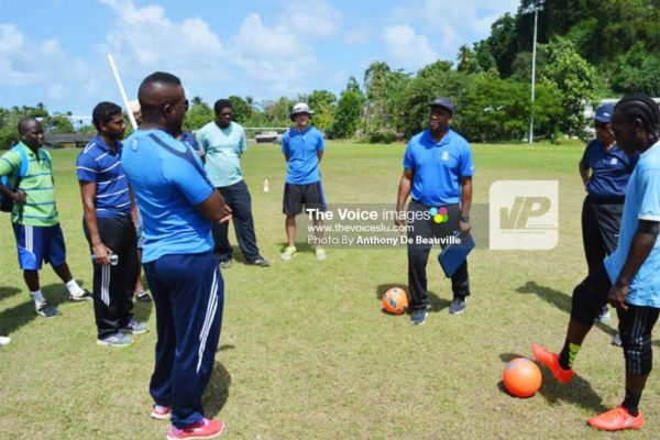 Image: (L-R) Local coaches listening attentively during a practical session