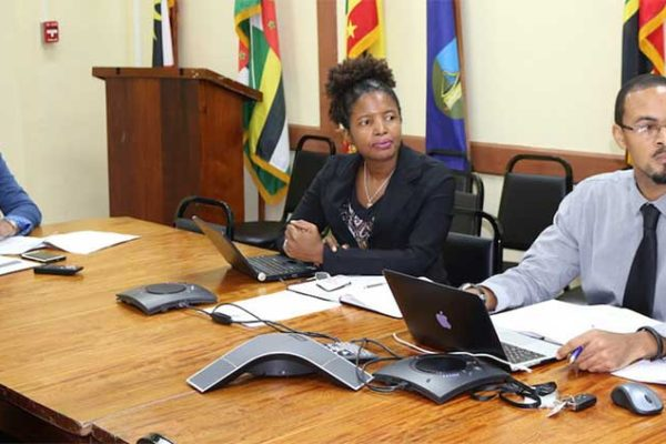 Image: OECS personnel at the meeting: Virginia Paul (centre) Head of the Trade Policy Unit, Tahira Carter (left) and Ramon Peachey (left) of OECS Communications
