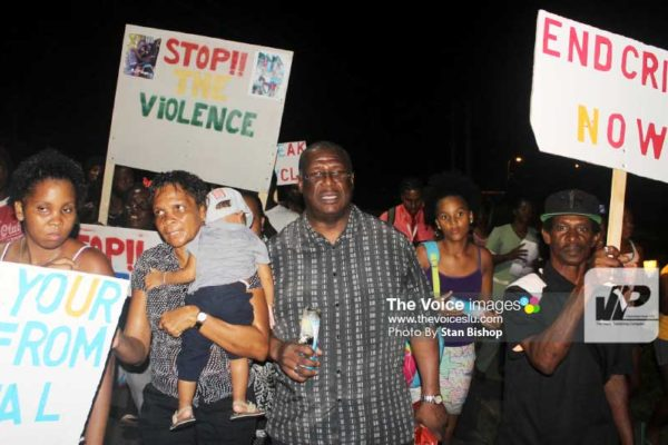 Image: Castries North MP, Stephenson King, leading the candlelight vigil and silent march last Tuesday evening in La Clery. [PHOTO: Stan Bishop]