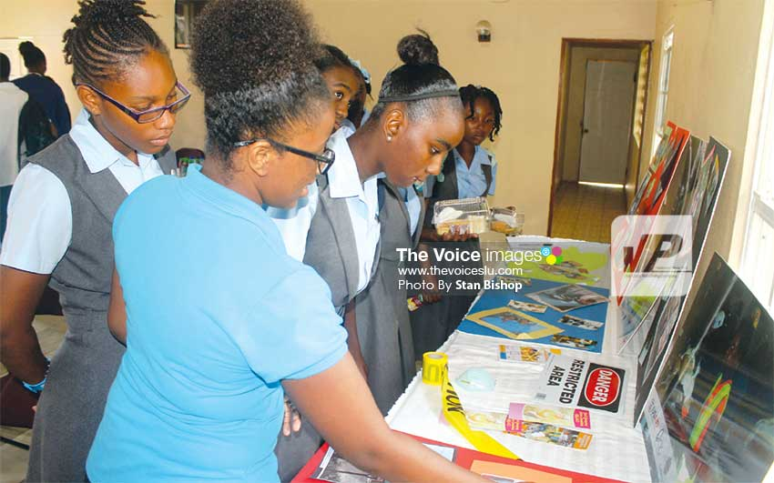 Image: A YEAC member explains to students various aspects of their operations. [PHOTO: Stan Bishop]