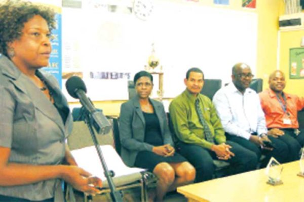 Image: Mrs. Brown making a presentation at a past JA function.
