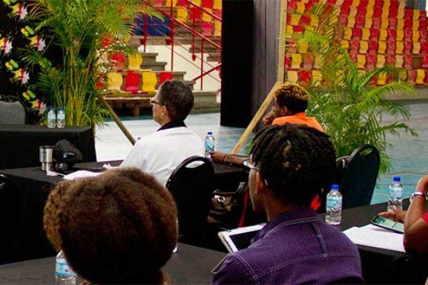 Image of Peter Rudge addressing workshop participants.