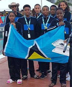 Image: Naima Hazel carrying the Saint Lucia flag with teammate Mikaili Charlemagne. (PHOTO: LASC)