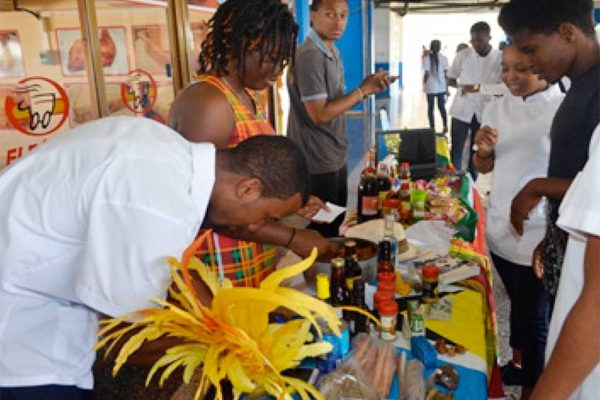 Image: St. Lucians displaying locally-manufactured products and snacks.